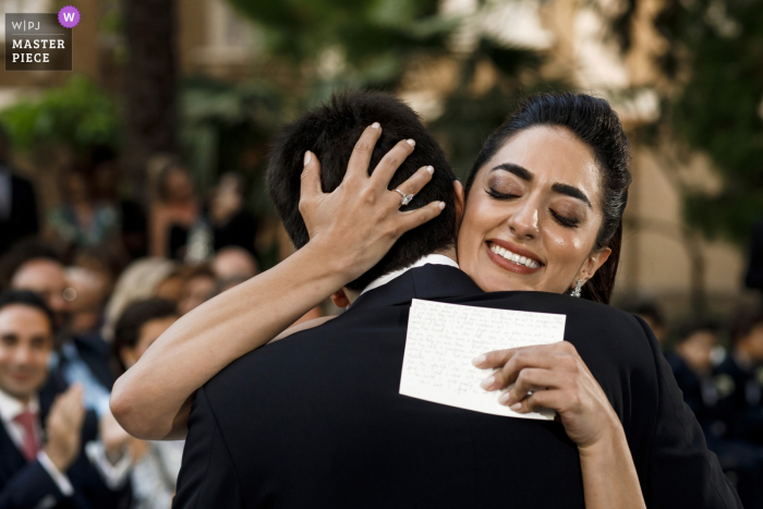Beirut, Sursock Palace wedding image showing the end of the wedding vows for the bride with a hug