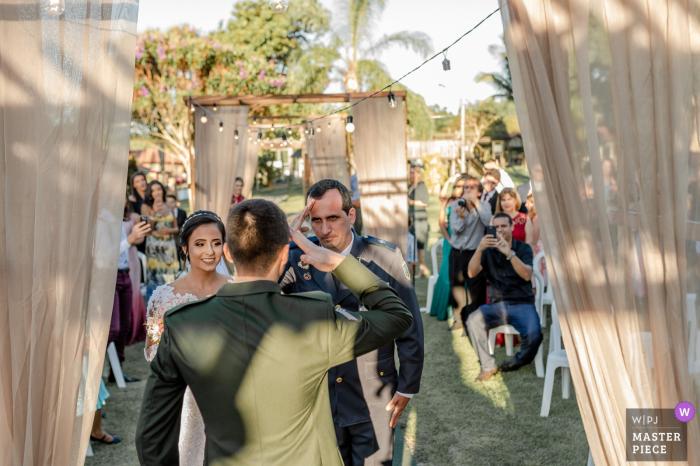 Outdoor Wedding Ceremony Venue: Cerimonial Sítio Santa Clara - Aracruz, Espírito Santo, Brazil - Photo of the Bride's father (High Patent Police Officer) saluting the groom (Brazil's army officer)
