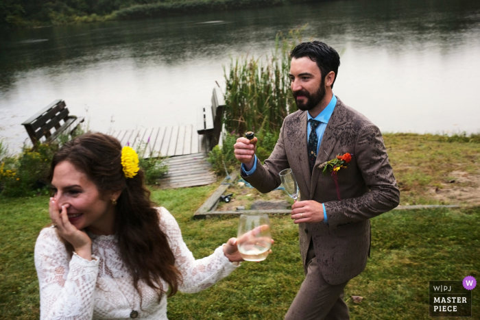 Private Home wedding photography in Connecticut - The bride and groom happy after popping champagne