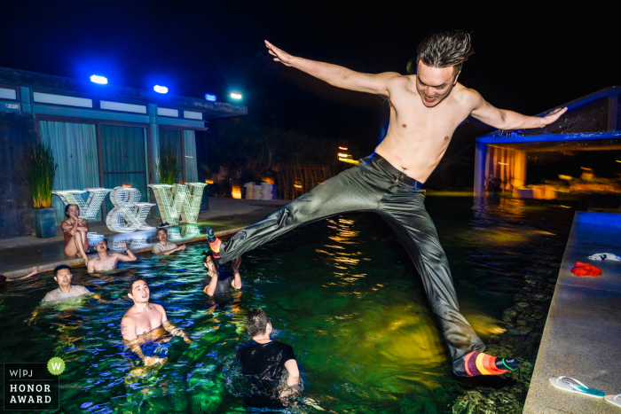 Sava Beach Villa wedding venue action photography - The groom was jumping into the pool at after party.
