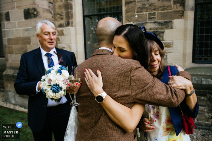 Mansfield Traquair, Edinburgh wedding image contains: Bride with her family during the drinks reception