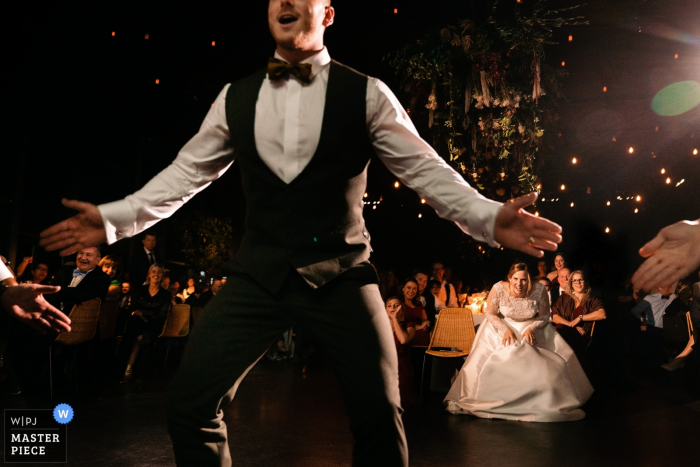 Flanders Reception wedding image contains: The groom doing a flash mob for his bride and shakes his booty