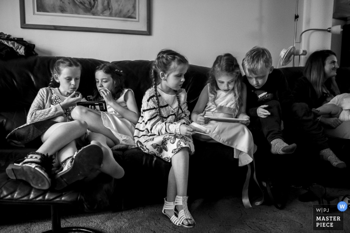 Hitchin, Hertfordshire Photographer: Kids playing on a computer during the wedding celebrations