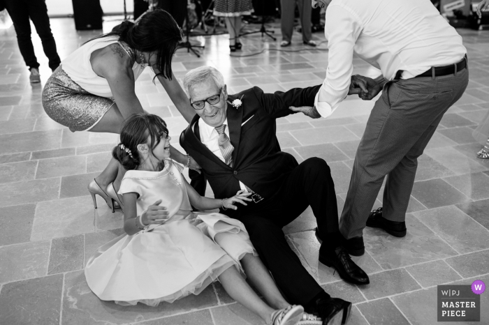Reception in Masseria Bonelli - Noci - Apulia - Italy wedding image | The grandfather (and father of the groom) improvised dancer loses control