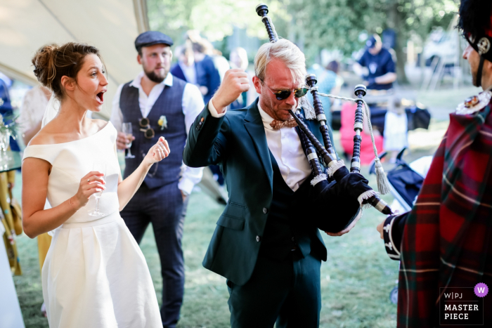 "Wedding picture at the reception venue - France | The difficult test of the ""Scottish Pipe"""