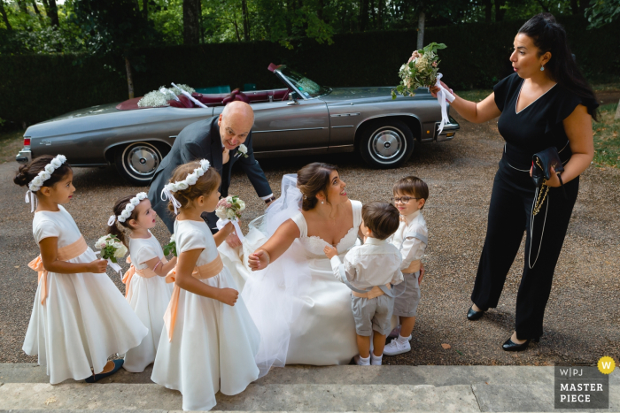 Paris Church Wedding Image Contains: The bride arriving at the church and discovering children of honor