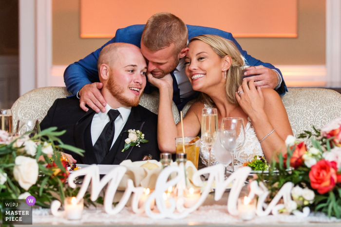 Wedding photo of the bride and groom with guest at their table at Bear Brook Valley, New Jersey