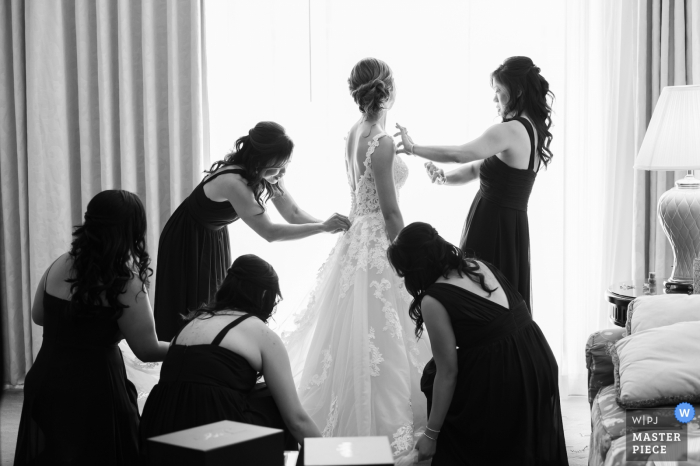 Florida Wedding Photographer: At the hotel.	The bride getting ready with her bridesmaids