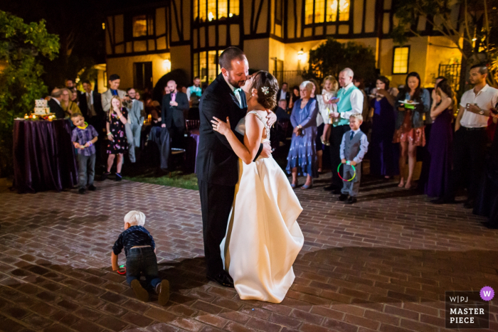Private residence, Saratoga wedding photographer: Don't mind me and continue with your first dance