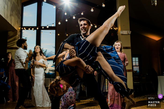 Colorado wedding image of guests on the dance floor doing some fun dance moves