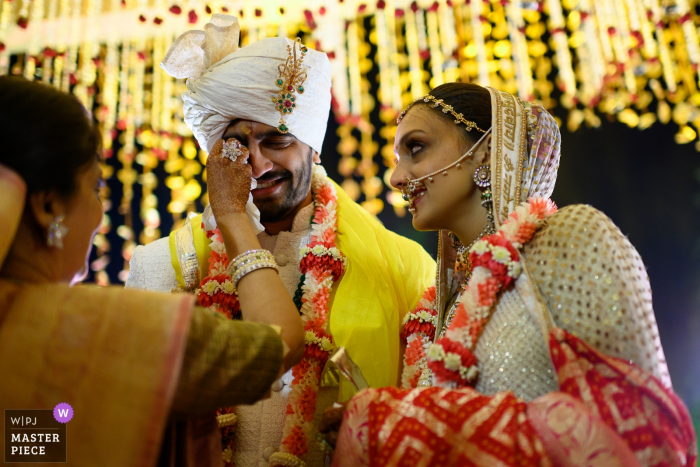 Kothari Garh, Jaipur wedding | Bride's mom wipes away groom's tears in the middle of a very emotional moment.