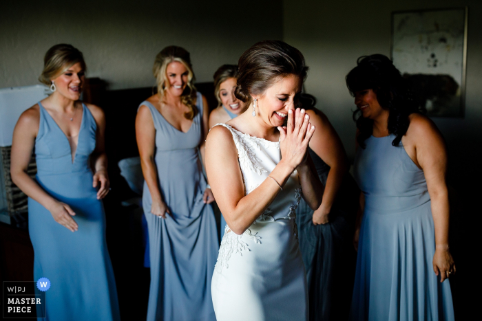 Ritz-Carlton Bachelor Gulch wedding venue photos | The bride excited about how she looks in her wedding dress with her bridesmaids support.