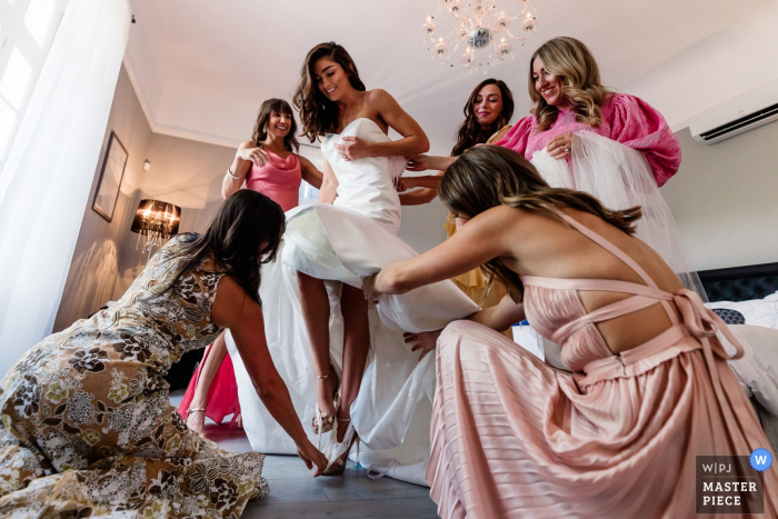 Wedding photography at a venue in Montagnac, France | The bride takes off her panties with these bridesmaid