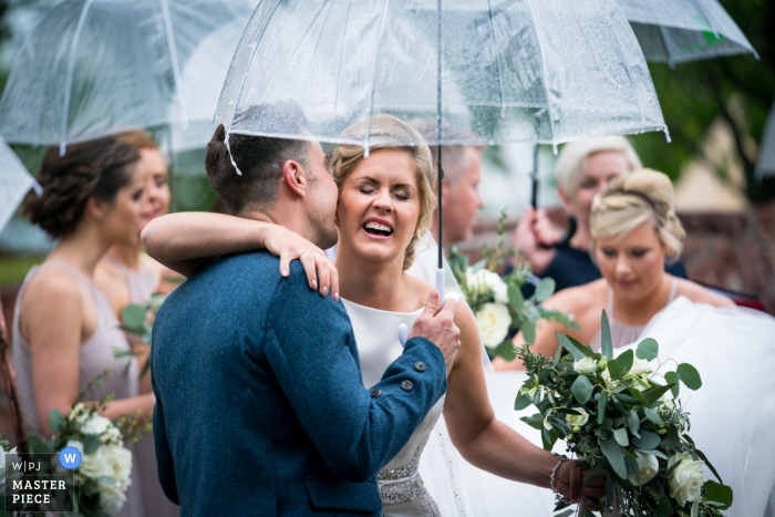 Photography of the wedding ceremony at the bride's home, Gartocharn, Stirlingshire | The groom whispers a greeting to the bride as she arrives at the alter