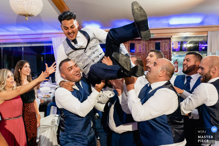 Mirador de Cuatro Vientos wedding venue photography | Groomsmen takes the groom in the air