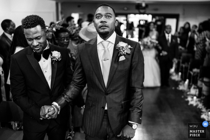 Kensington Temple, London wedding ceremony photo | The Groom and Best Man as the Bride approaches