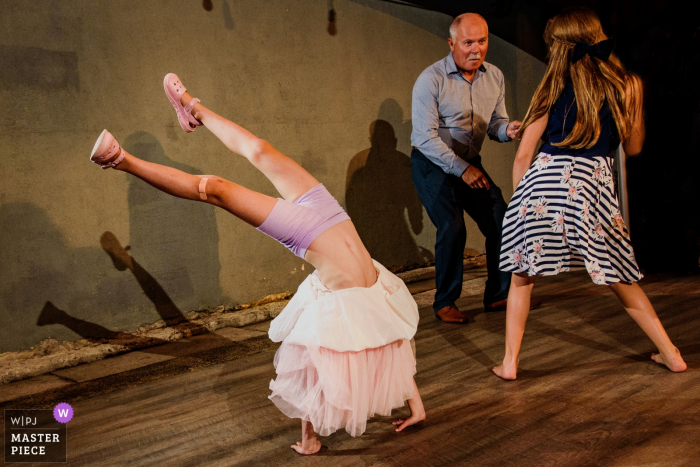 Blaylock Mansion, Nelson BC wedding reception venue photography | The flower girl does handstand on dance floor