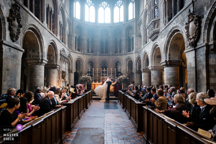 Ceremony photography at a wedding inside St Bartholomew the Great, London | Bride and Groom's first kiss