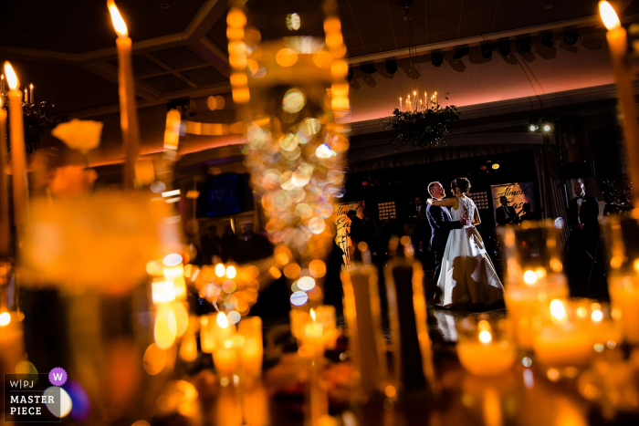 Fiddlers Elbow Wedding Venue Photography | First dance between candles and glass.