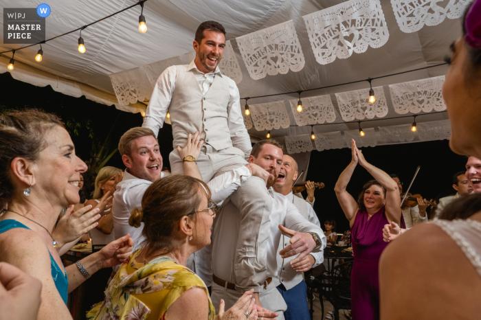 Casa Villa Verde, Puerto Vallarta Wedding Reception image of the bride and groom partaking in the Hora Dance