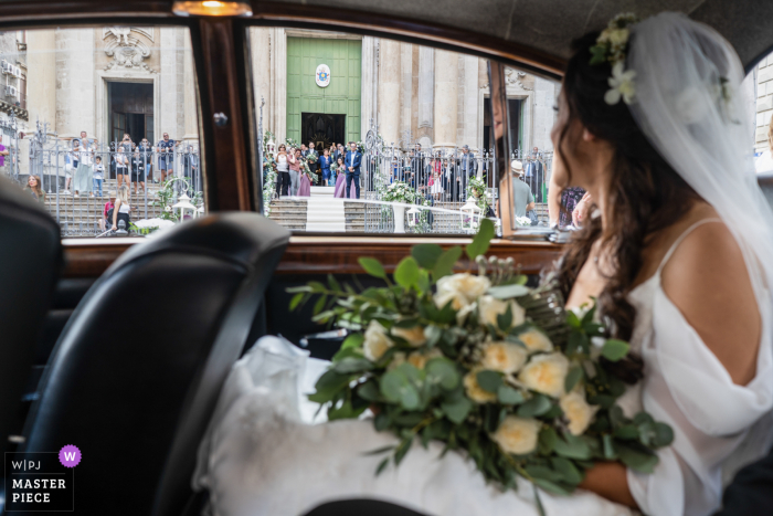 Sicily Church Wedding | The bride is arriving at the church with her guests waiting at the steps
