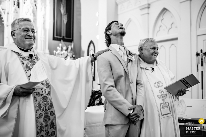 Saint James Catholic Church in Seguin Wedding   Emotional groom as he sees his bride walking down the aisle