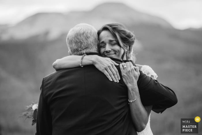 Colorado Outdoor Ceremony Wedding Image of the bride hugging dad after ceremony