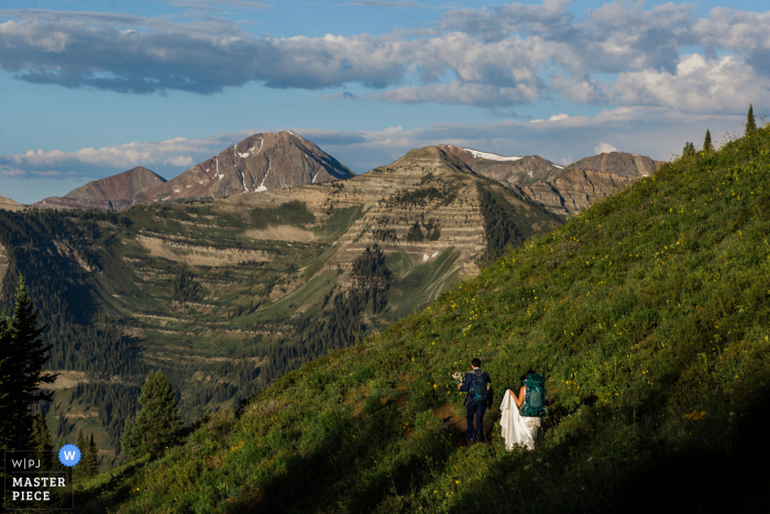 Colorado Outdoor Elopement Photo | Couple hiking towards the ceremony spot