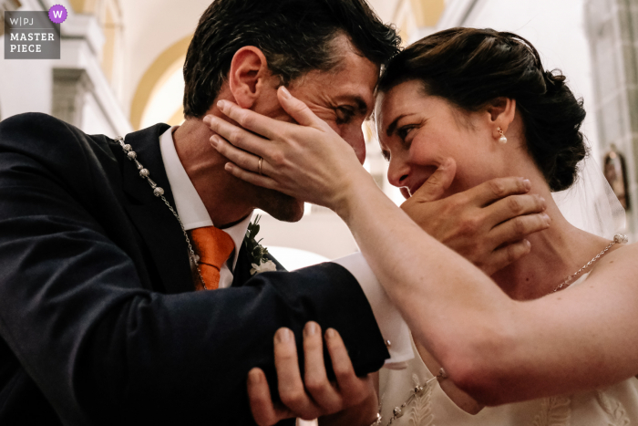 Oaxaca City wedding ceremony image of the bride and groom touching each other's faces