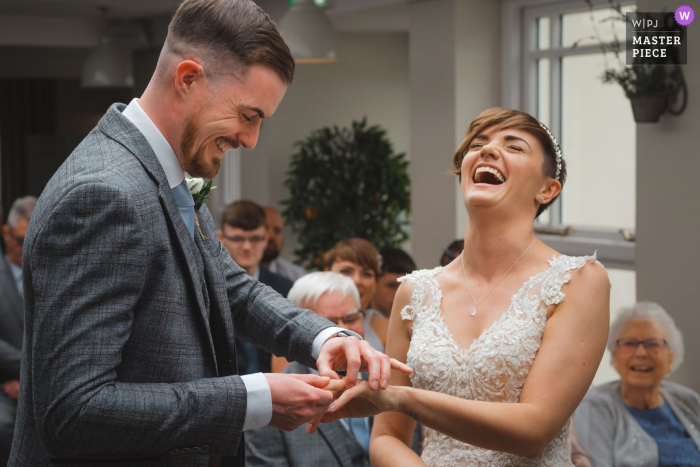 East Midlands Wedding Photographer | groom struggling to place ring on bride