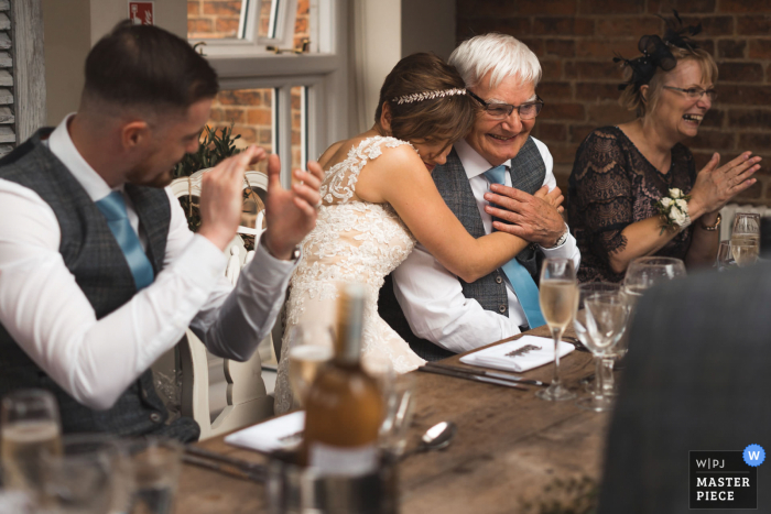Kedleston Country House, reception image of the bride hugging father after his speech