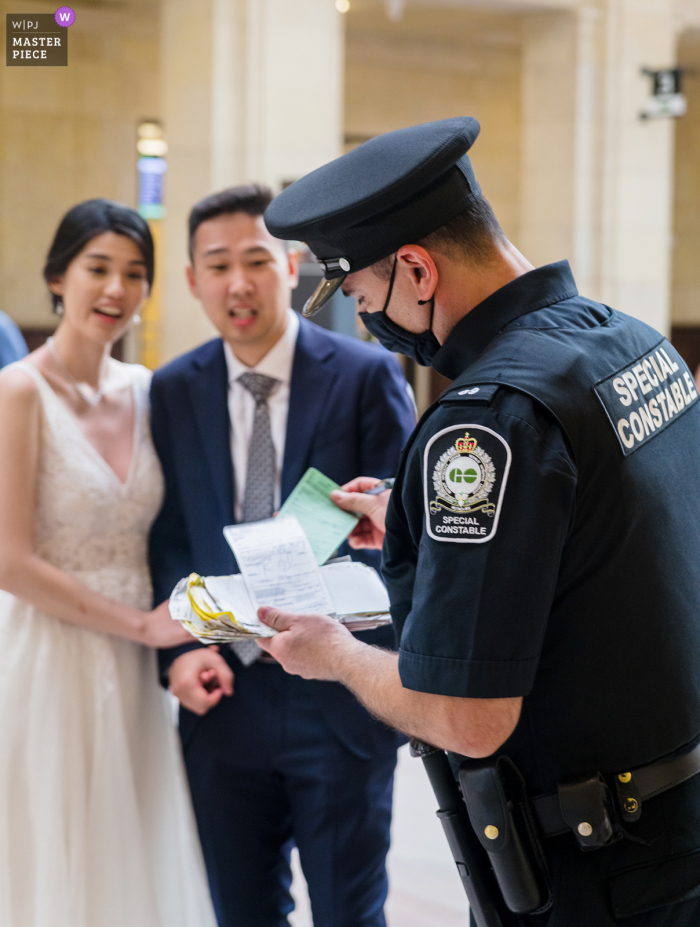 Union Station, Ontario Wedding Photo | Cop caught us without permit and issued a ticket to bride and groom - I thought to capture this moment