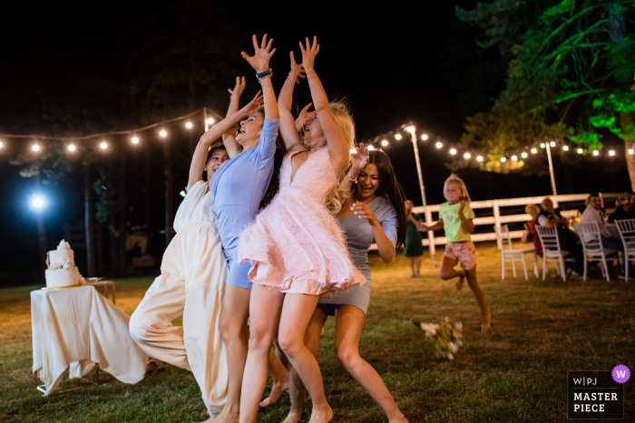 Guest House Ongal, Bulgaria Wedding Photographer   Bridesmaids fighting to catch the bridal bouquet.