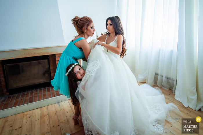 Guest House Ongal, Bulgaria Wedding Image of the Flower Girl and the Maid of Honour helping the Bride to dress up