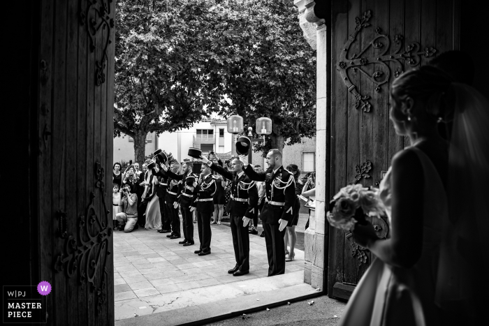 French Church Wedding Photo | Exit from the bride and groom's church with a military guard of honor