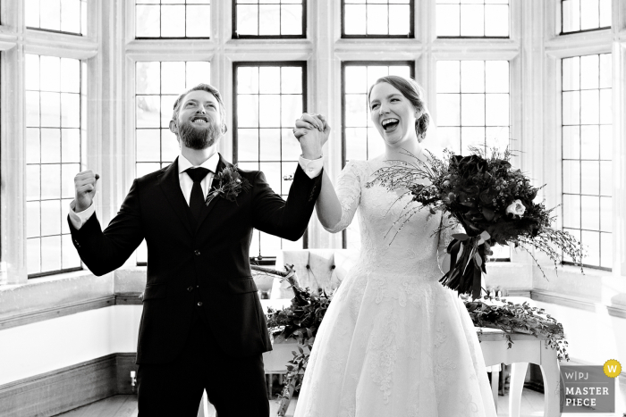 UK wedding photography from the England 		Coombe Lodge showing Pure joy after announcing the couple husband and wife