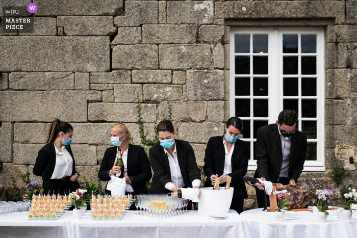 France wedding reception photo from Moelien Castle of masks on vendors Getting cocktail ready