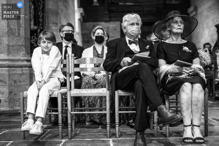 wedding photo from a ceremony in France Quimper of guests waiting Too long with covid 19 masks on