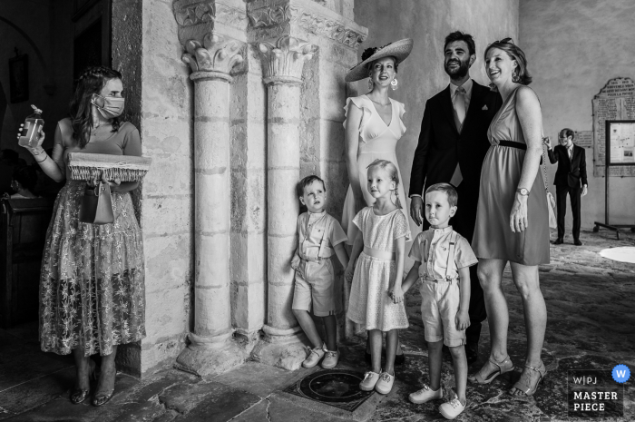 France wedding photo from Bourges of a spy waiting with hand sanatizer for covid