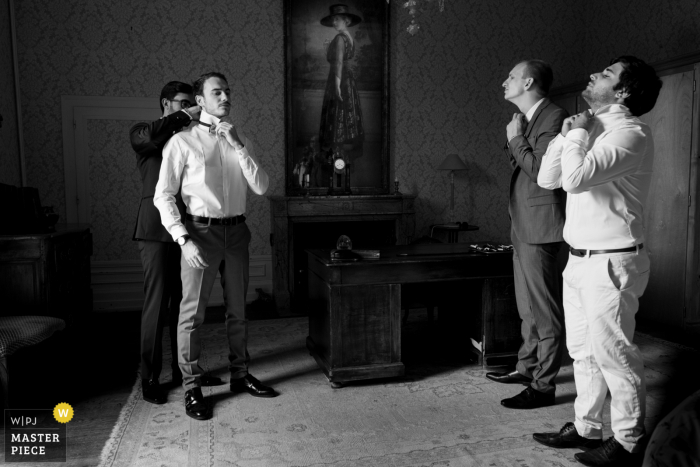 wedding photo of guys getting ready at Chateau Rocher