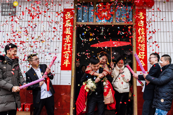 China actual day wedding photo from Sichuan at The bride's home of The bridegroom carrying the bride, They are going to leave the bride's house and go to the bridegroom's house