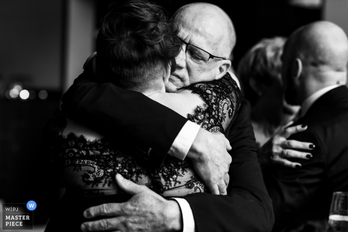 Noord Brabant wedding photo from the Netherlands Reception Venue of The father of the groom hugging the bride.
