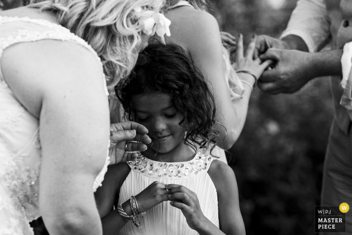 Noord Brabant wedding photo from outdoor Ceremony of The two daughters are getting a ring as a symbol of love to their parents