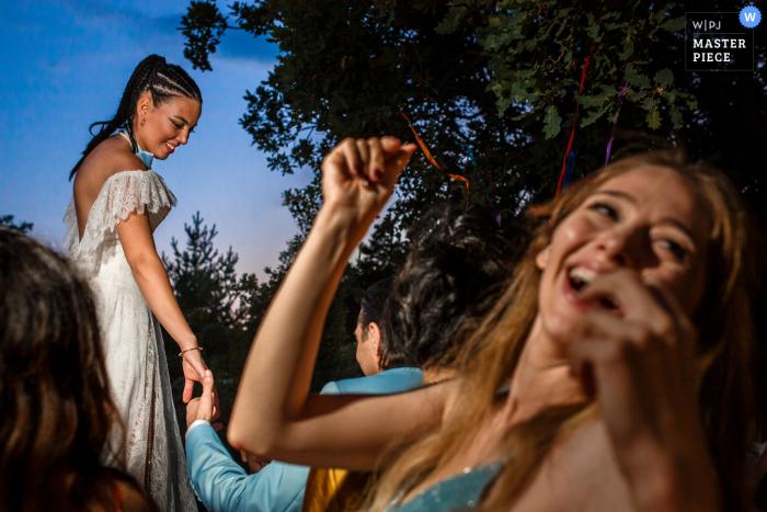 Kizilcahamam, Ankara, Turkey wedding image of the bride is inviting the groom to the table