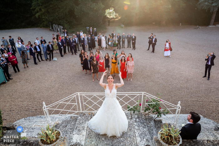 Villa Emma de Poitier wedding image of the bride throwing her bouquet to the awaiting women