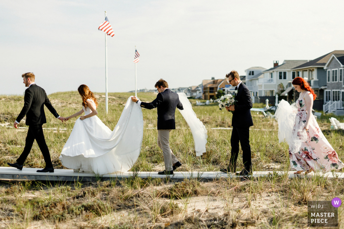 Cape Cod Wedding Photography | Bride and groom and their friends going to the beach