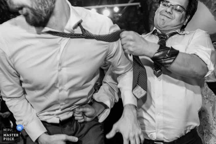 Mexico wedding photo from Instituto Allende, San Miguel de Allende showing A wedding guest punching and grabs his friend on the dance floor