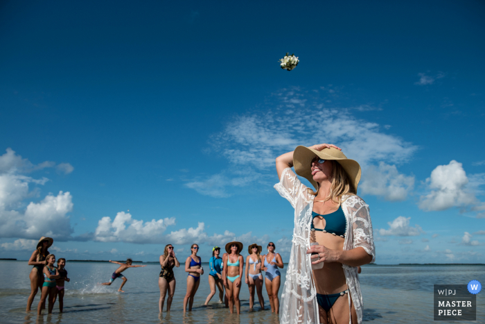 Florida beach wedding photo from Marvin Key, Key West showing the Small wedding bouquet toss
