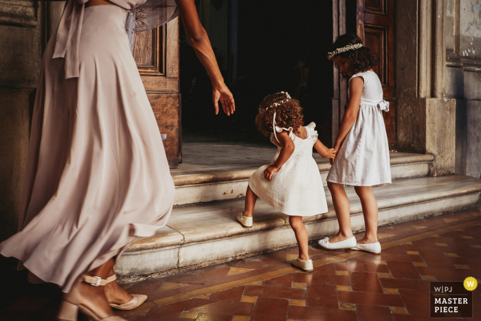 Indoor kids wedding photo from Chiesa delle Stimmate, Roma of the Flower Girls entering the Church