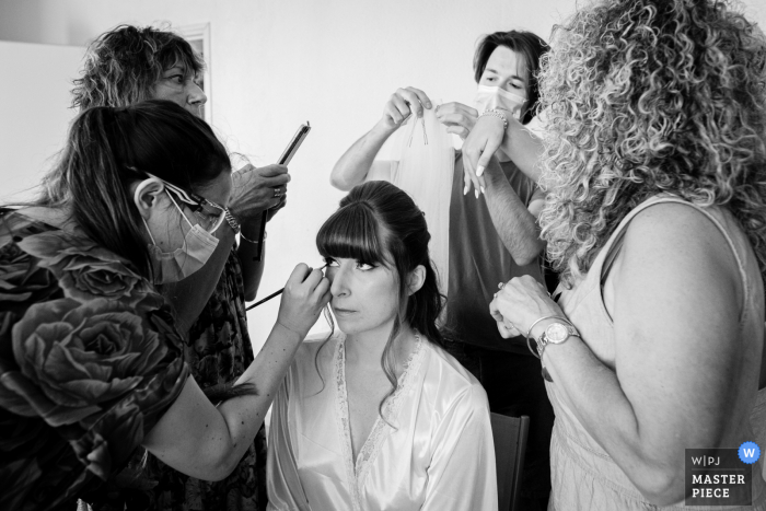 Getting ready wedding photo from Château de Nolet, Aucamville, France of the bride getting help with hair and makeup